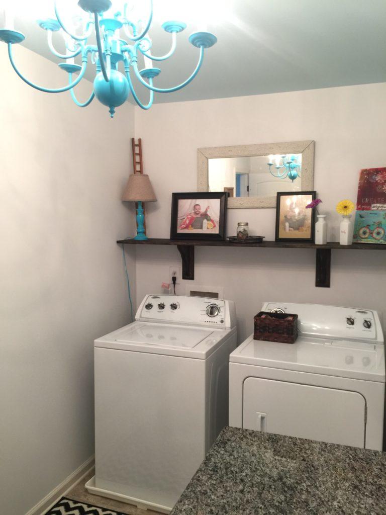 small laundry room budget makeover chandelier diy shelf