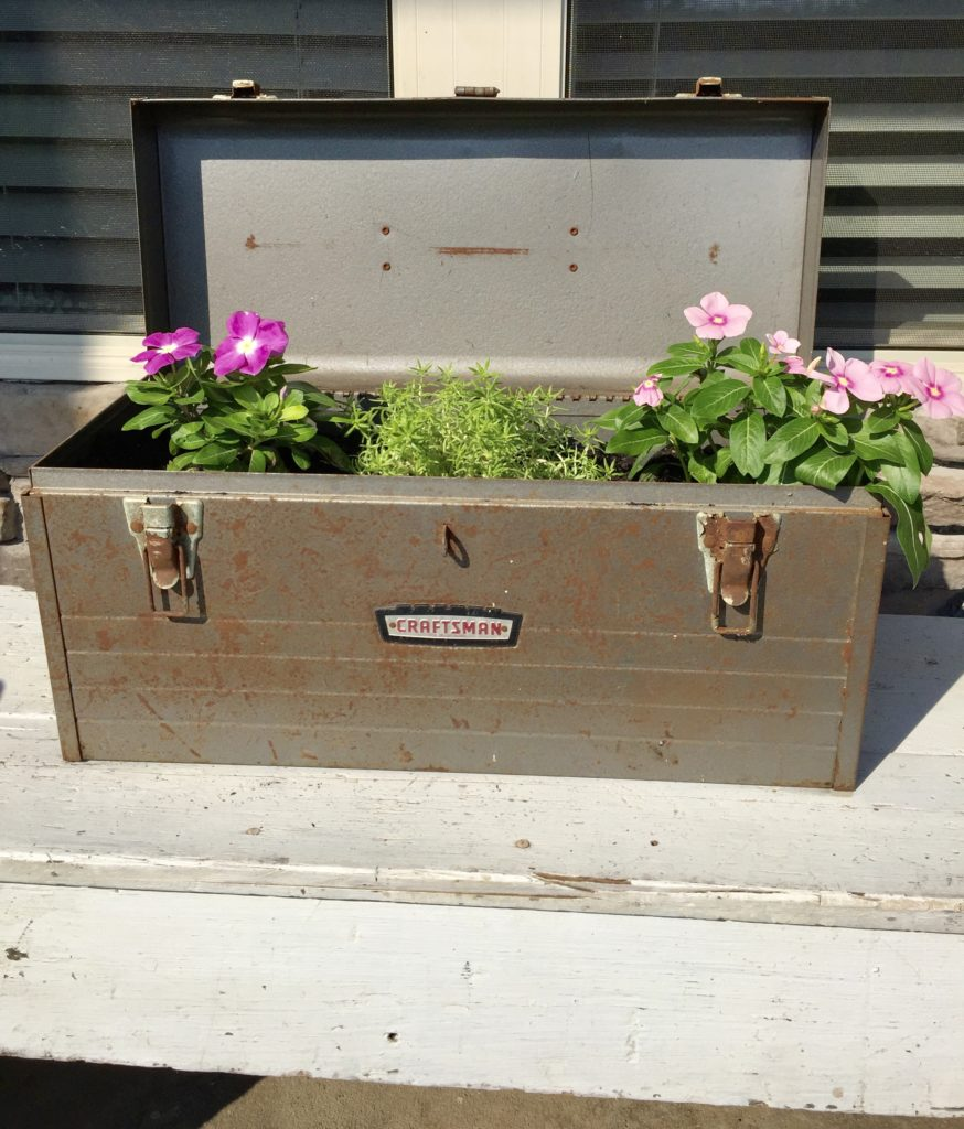 DIY farmhouse style planter using a rusty craftsman toolbox