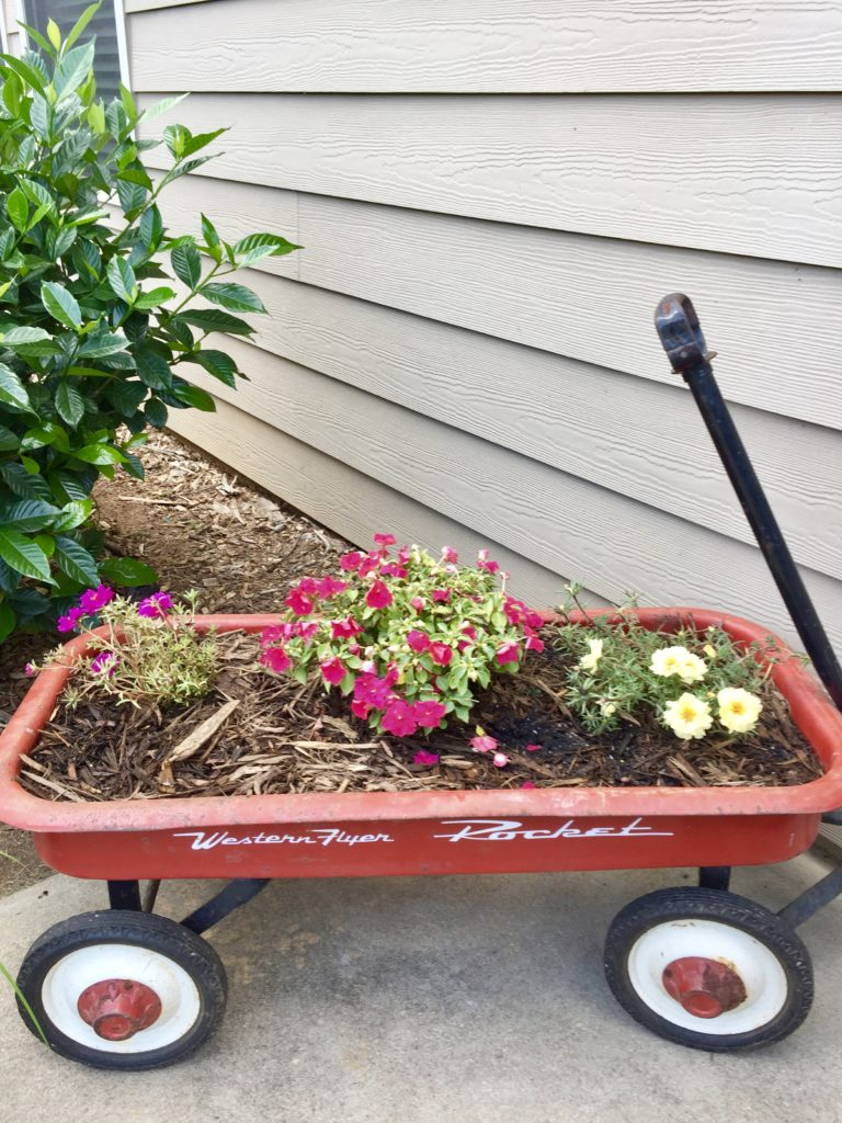 DIY Farmhouse style planter from a rusty red wagon