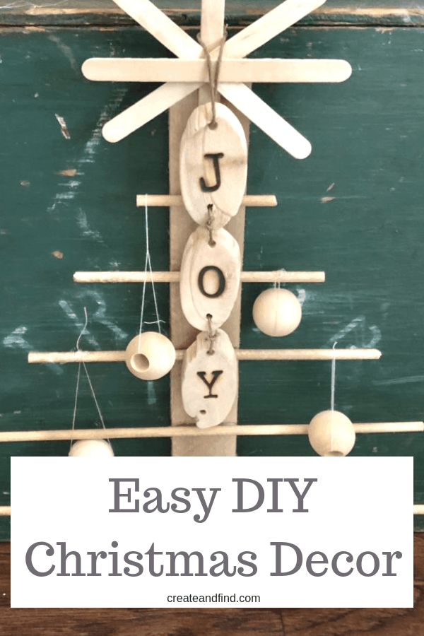 An easy diy project for Christmas decor - a simple rustic tree made from wood shims, dowels, and glue #createandfind #christmasdecor #diychristmasdecor #diytree