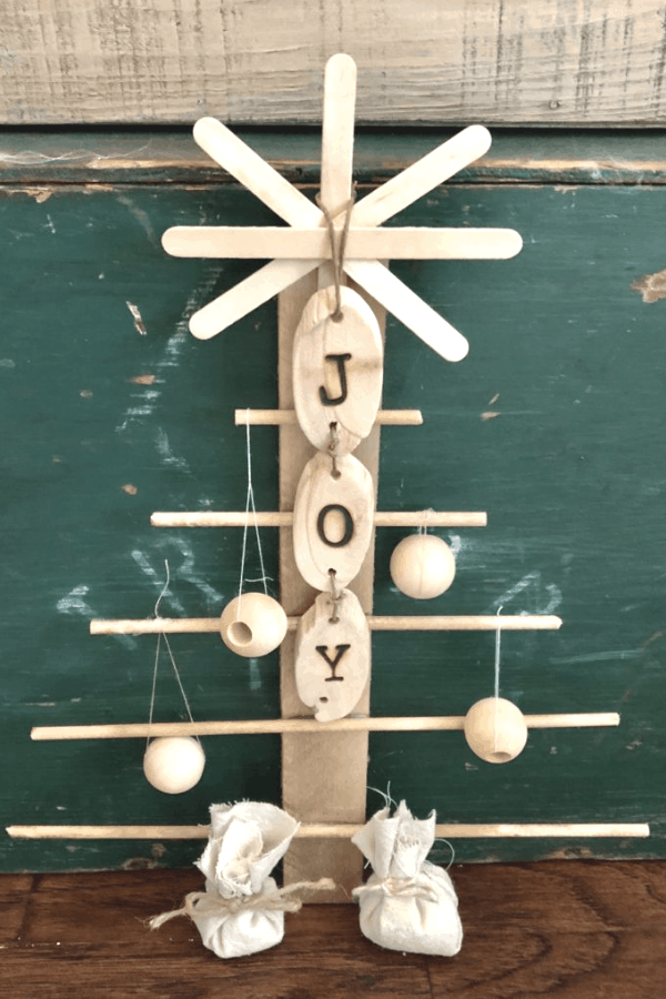 DIY Rustic tree - a simple and easy Christmas DIY Project using craft store supplies #createandfind #diychristmasdecor #christmasdecor #diytree