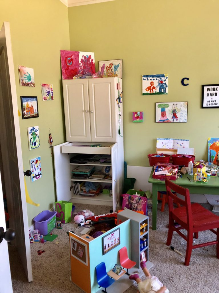 playroom challenge before art cabinet