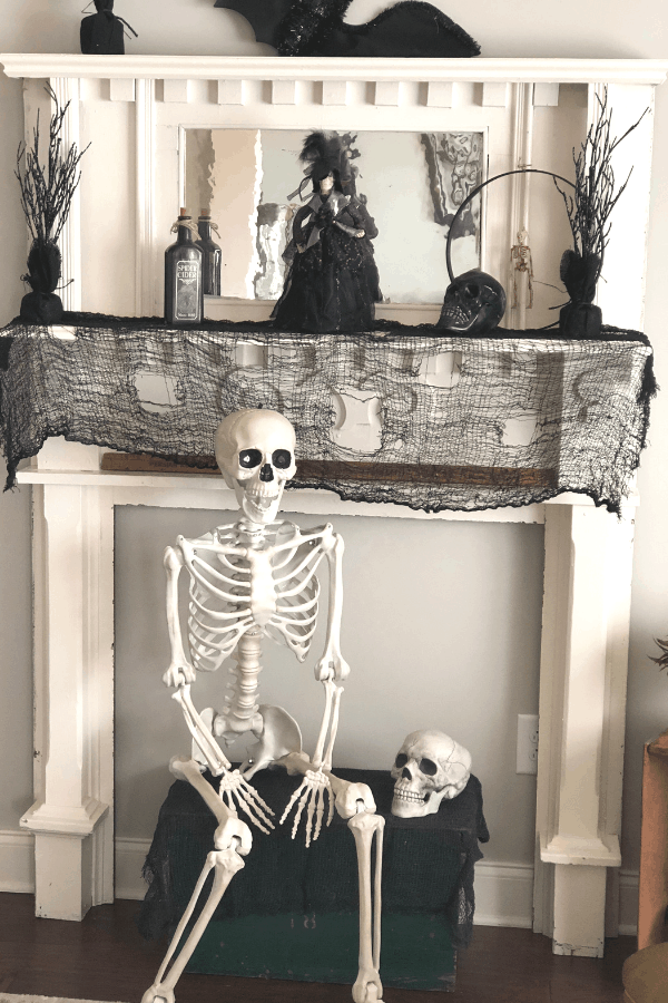 Cheap halloween decorations for a spooky house tour. Dollar store decor for a spooky house tour #createandfind #cheaphalloweendecorations #skeletons