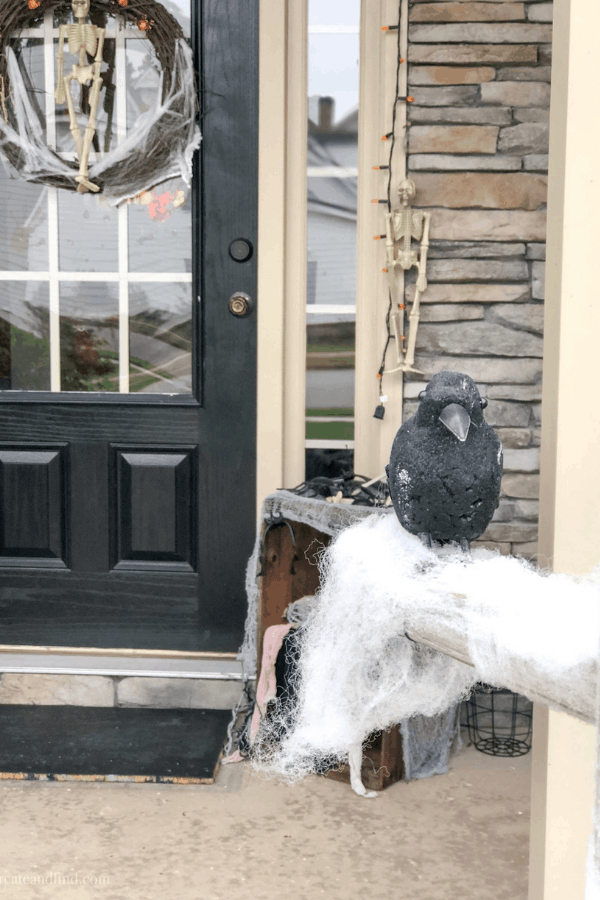 Dollar tree porch decoration for Halloween and an easy DIY halloween wreath #createandfind #dollartreehalloween #halloweenwreath #halloweenporch