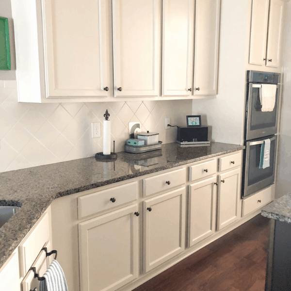 How to DIY your own kitchen makeover by painting your own cabinets #createandfind #kitchenmakeover #howtopaintcabinets