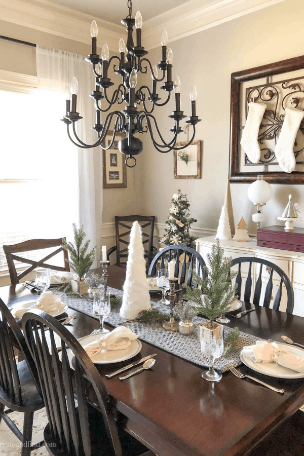 Simple Christmas decor - white, green, silver and black Christmas accents in the dining room #createandfind #simplechristmasdecor #christmas #christmasdiningroom
