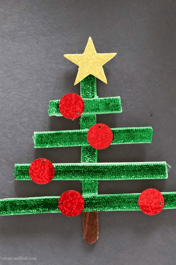 Easy popsicle stick ornaments to make with the kids. A simple Christmas craft project you can make with a few supplies and very little time #createandfind #christmascrafts