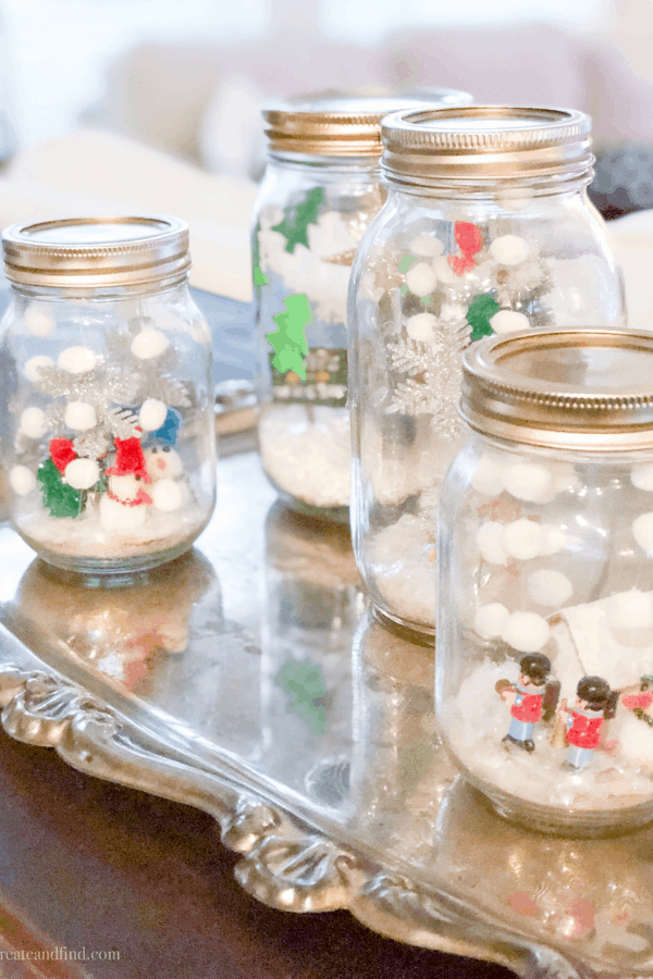 Easy Christmas Crafts for kids mason jar snow globes - christmas decorating on a budget