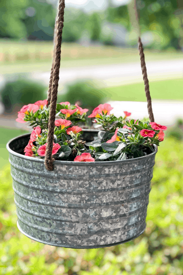 Front porch decor with calibrachoa in containers