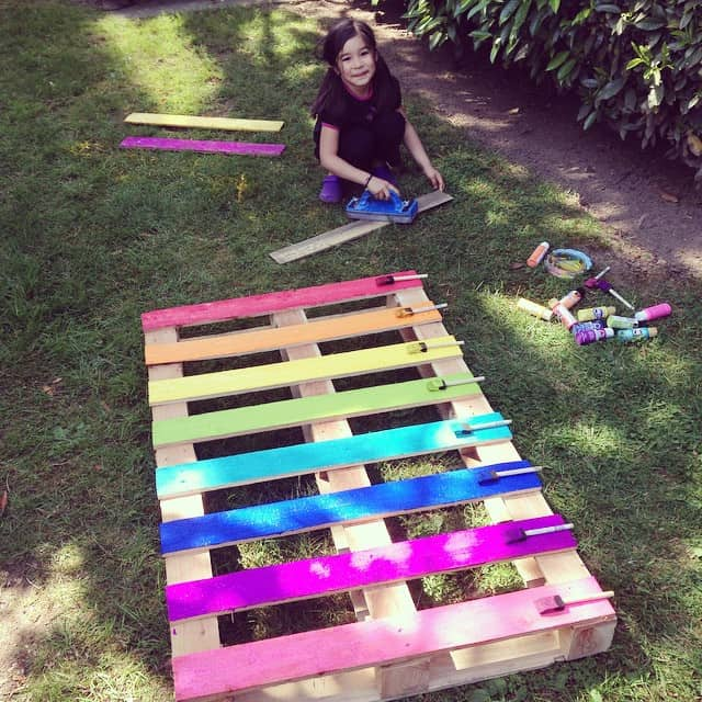 They painted an old pallet in rainbow colors... Can you guess what it turned into?