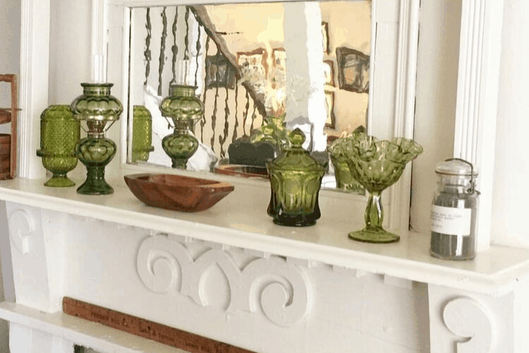 green glass on a mantel
